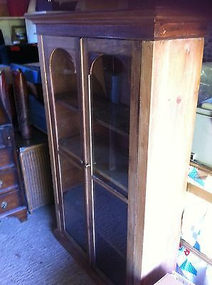 Glass fronted pine bookcase with original glass 137 H 85 W 30D