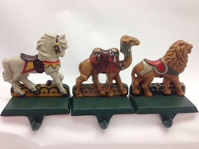 3 Vintage Cast Iron Stocking Hanger Carousel Camel Lion Horse Christmas Lot