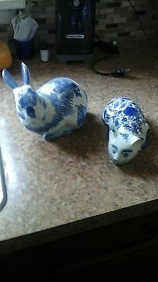 Blue and white rabbit and cat