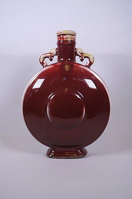 Chinese Sang de Boeuf twin handled moonflask, 4 character mark to base, 35cm.