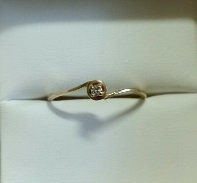 Genuine 14ct gold solitaire twist diamond ring