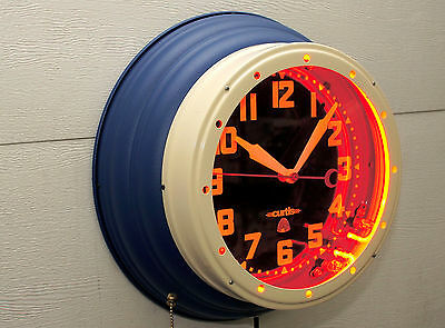 "A 16"" Blue & Cream W/Red dots. "" Beehive Neon Clock""  By Curtis"