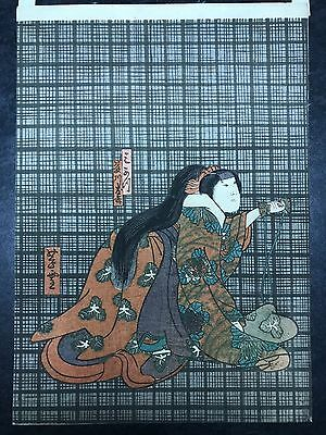 Original Japanese Woodblock Print Lady holding a bag on a plaid background