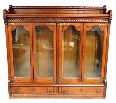 Bookcase, Eastlake, c. 1880, gallery top with carved linear motif, sup... Lot 32