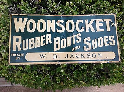 Vintage Woonsocket rubber boots and shoes sign