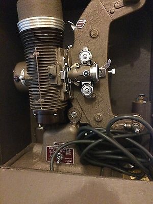 Bell & Howell 8mm Projector and accessories