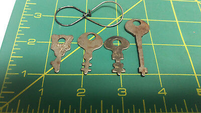 Set of 4 keys on nifty old ring - One looks like a home made flat skeleton key