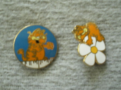 2 Garfield pins-on fence and sleeping on flower/daisy