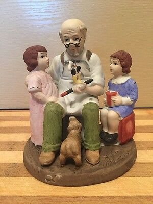 """NORMAN ROCKWELL figurine """"The Toy Maker"""" ceramic statue replica; vintage 1980's"""