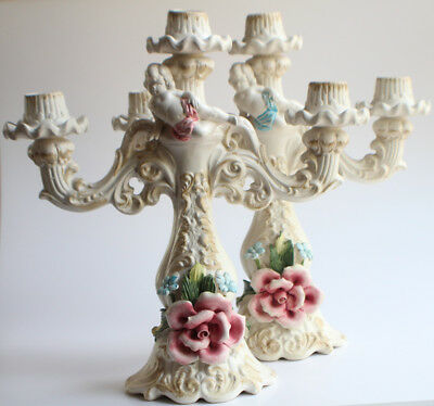 Pair of Capodimonte Porcelain Candelabras Floral and Cherub adornment Italy