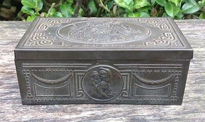 Old Metal Tin Wooden Lined Box With Classical Scenes Embossed On The Sides