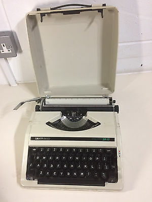 Vintage Silver Reed SR12 Portable Typewriter with Hard Carry Case in White