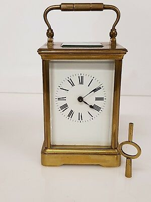 Fine Antique Striking brass cased four glass carriage clock