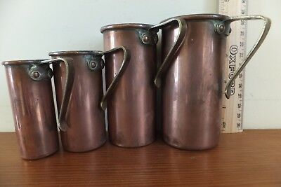 Antique Arts and Crafts copper stacking baking  cup measures. one cup, half cup-