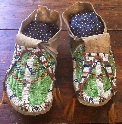 1880's Sioux fully beaded moccasins with beaded drops.
