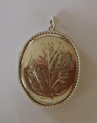 An Ornately Engraved Sterling Silver Large Photo Locket Pendant Birmingham 1976