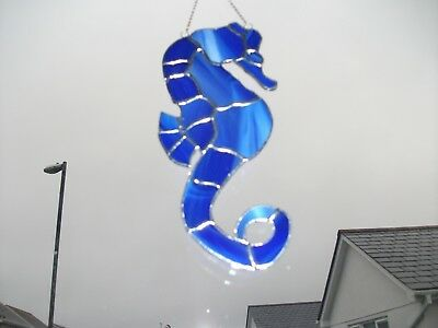 Handmade Stained Glass seahorse Sun-catcher made in blue and white wispy glass