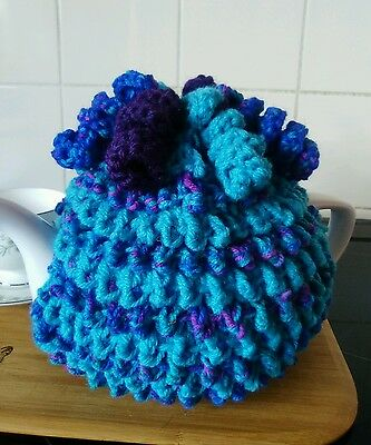 Handknitted multi colour spiral tea cosy