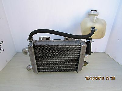 Peugeot Elyseo 125 Radiator And Fan. Bottle Head Tank Included.genuine