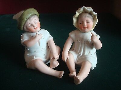 PAIR OF EARLY 20th CENTURY? PORCELAIN MOVING HEAD BOY & GIRL FIGURES