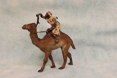 "4"" Tall 4-1/2"" long Lead camel with bearded Arab rider, cold painted circa 1900"