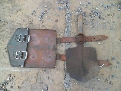 Old vintage digging hand tool with leather sheath/cover
