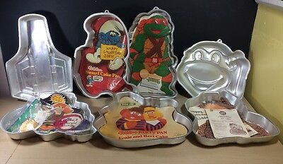 Vintage Wilton Cake Pan Lot Of 7 He Man Ninja Turtles Alf Smurfs Rocket Burt Ern