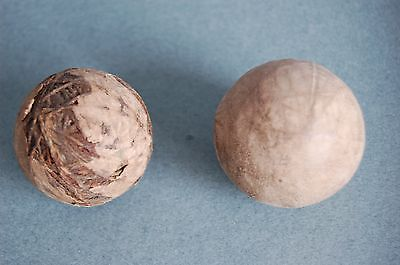 Vintage Golf Balls. one in good condition for age, one very well worn.
