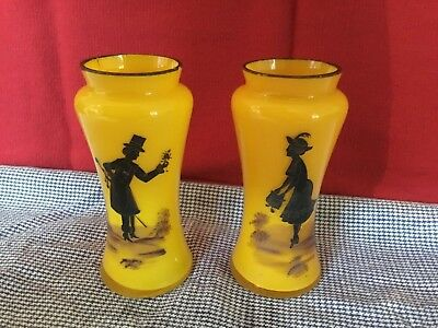 Art Deco pair of yellow glass vases with black silhouette characters