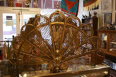 Brass colored metal collapsible fireplace screen