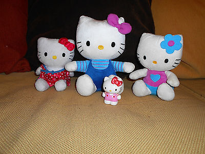....Lot 3 peluches HELLO KITTY 21 cm + figurine .....