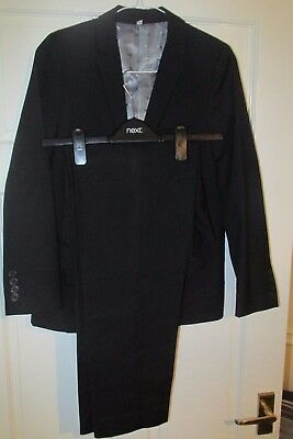 Boys Black M&S Suit  Aged 11-12 years Polyester. Worn once. Grey satin lining