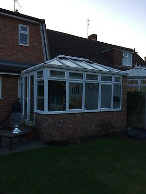 Conservatory glass double glazed French doors white upvc pitched roof orangery