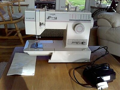 Singer Sewing Machine with foot control, case and instruction book