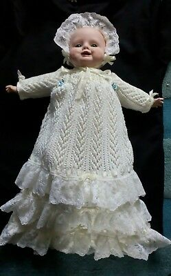 Antique Reproduction Baby Doll with porcelain head and hands