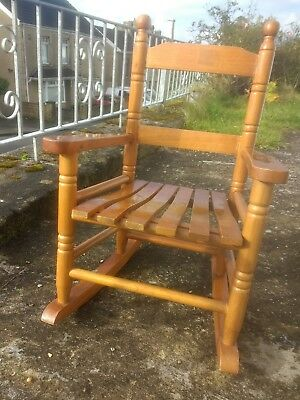 Rocking chair all wood for child or toy, traditional shape.