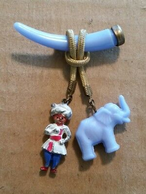 Vintage Plastic Elephant & Mahot Hanging From Tusk Pin,1940's