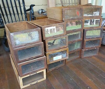Industrial wooden and glass cabinet drawers circa 1940's.