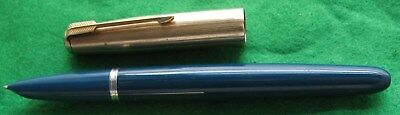 A Teal Parker 51 Fountain Pen With A Gold Plated Cap