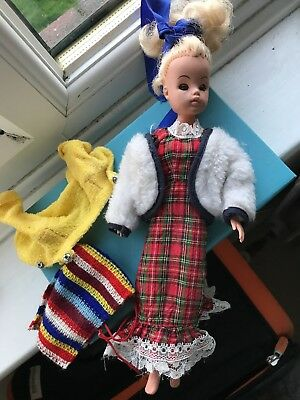 Vintage 1970's Sindy Doll with moving eyes  and few Clothes