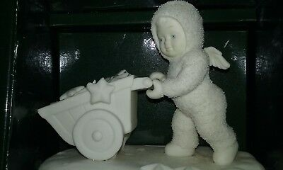 Snowbabies model.Little angel with a wheelbarrow full of stars. New in box.