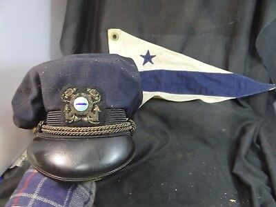 vintage steamship captains cap and flag.actually a yacht club hat 1950's