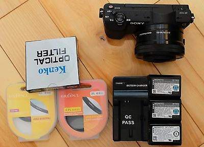 Sony a5100 mirrorless with 16-50mm kit lens. 24 megapixels. With extras.Like new