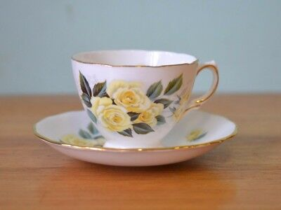 Vintage Royal Vale teacup & saucer duo yellow flowers 3204