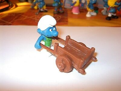 """Puffo Smurfs    """" Con Carriola  """"  Made In W. Germany  78     Peyo    Ottimo"""