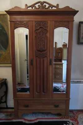 Ornate Victorian double wardrobe with lockable mirrored doors