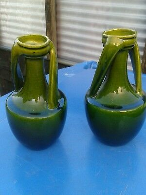A pair of bretby vases