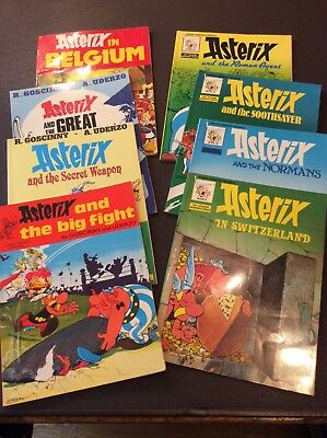 8 Asterix books, see description for details. By goscinny and uderzo