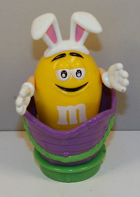 """3.25"""" Yellow Peanut M&M's Easter Bunny Plastic Figure In Basket"""