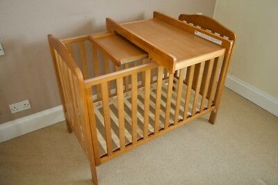 Mothercare wooden cot bed and baby changing table.
